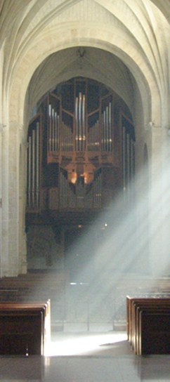 organ in the nave of church solesmes